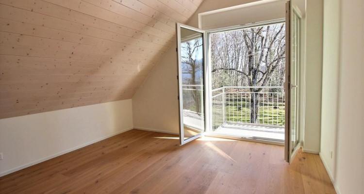 Espace et élégance pour ce duplex 5,5 pièces avec vue image 8